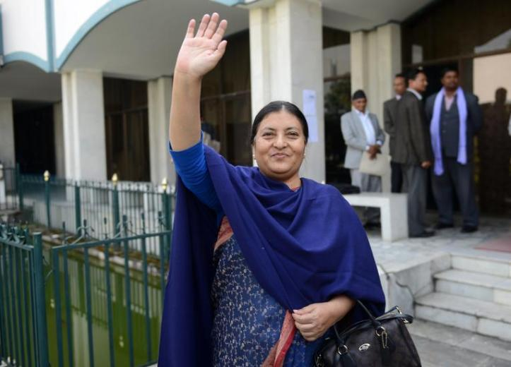 Nepalese presidential candidate nominated by the Communist Party of Nepal (Unified Marxist-Leninist) (CPN-UML), Bidhya Bhandari, waves after casting her vote in an election for Nepal's new president in Kathmandu on October 28, 2015.  The legislature was to vote on October 28 for a replacement for Ram Baran Yadav as ceremonial head of state, as required under the new constitution adopted last month.       AFP PHOTO / Prakash MATHEMA