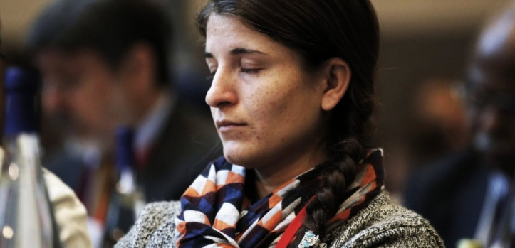 "Jinan Badel, the Yazidi author of the book ""Jinan, Daesh's Slave"" close her eyes as she listens to speeches during the opening of an international conference on the religious and ethnic minorities being persecuted under the Islamic State group, in Paris, France, Tuesday Sept. 8, 2015. The conference includes high-level representatives from more than four dozen countries as well as international organizations and religious leaders. (AP Photo/Francois Mori, pool)/XFM113/296095537876/POOL IMAGE/1509081249"