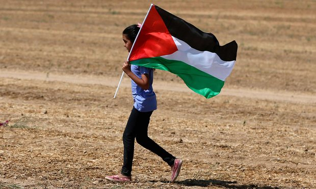 An Arab-Israeli girl holding a Palestinian flag. 'There is no need to embellish the Palestinian case with false and misleading analogies.' Photograph: Ahmad Gharabli/AFP/Getty Images