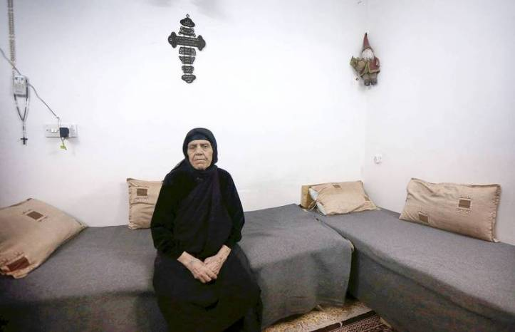 Zarifa Bakoos Daddo, 77 ans, n'a quasiment pas quitté sa maison à Qaraqosh durant les deux années passées sous le joug de l'EI. Safin Hamed/AFP